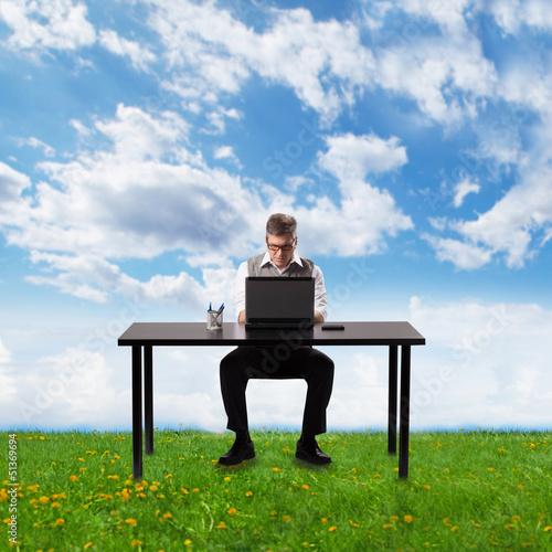 Businessman working with laptop.