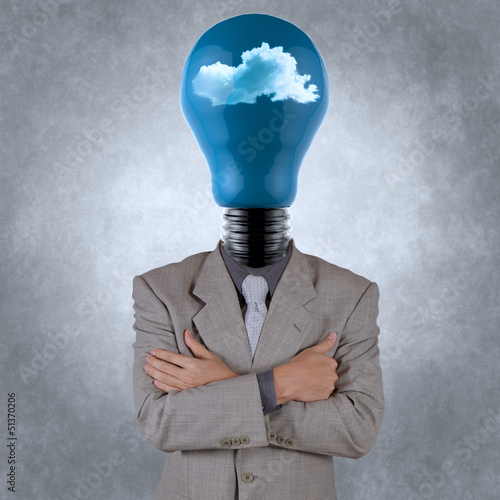 businessman with lightbulb head in the clouds