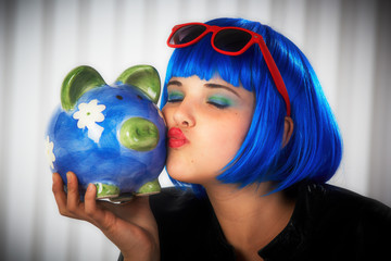 teenager girl with piggy bank