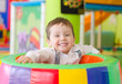 Happy little boy playing in playroom