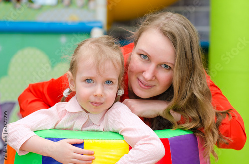 Portrait of woman and little girl in playroom
