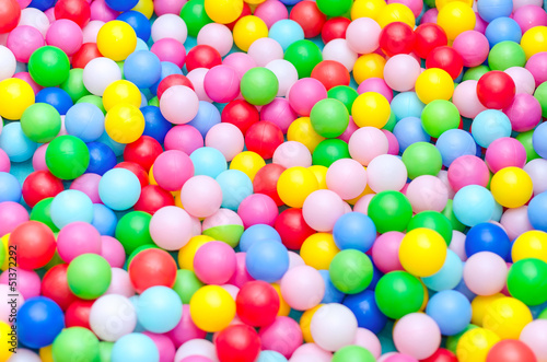Poster A lot of coloured plastic balls in playroom