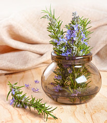 Rosemary twigs in a glass bowl