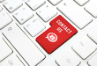 Contact us business concept, red key on white keyboard