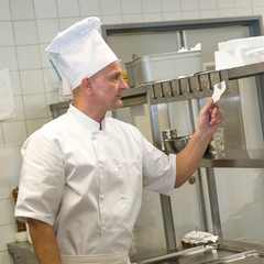 Chef reading orders in restaurant's kitchen