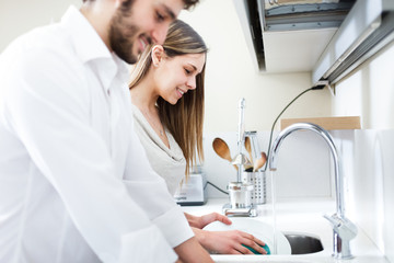 Young couple doing dishes