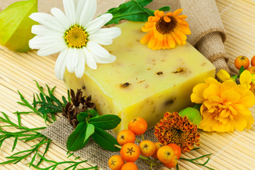Composition from natural soap, berries and flowers