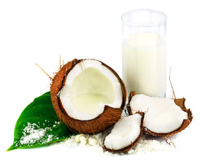 Coconut with glass of coconut milk and green leaf