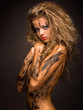 sexy and innocent woman with paint smudge on her naked body