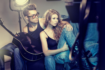 sexy fashionable couple wearing jeans posing dramatic