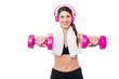 Woman enjoying music while doing dumbbells