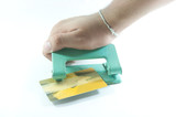 Hole puncher with credit card  in front of a white background