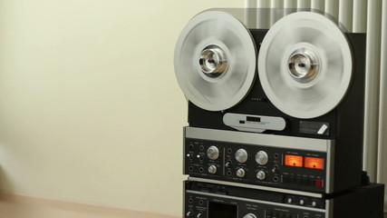 Retro Audio tape recorder rewind the tape
