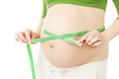 pregnant woman measuring belly