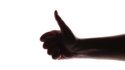 Silhouette of woman's hand giving thumb up on white background.