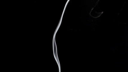 Thin smoke on a black background.