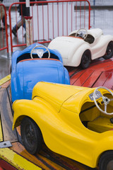 Colorful toy cars at attraction