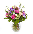 bouquet of pink and violet flowersin vase isolated on white