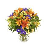 Fototapety bouquet of orange lilias and irises in vase isolated on white