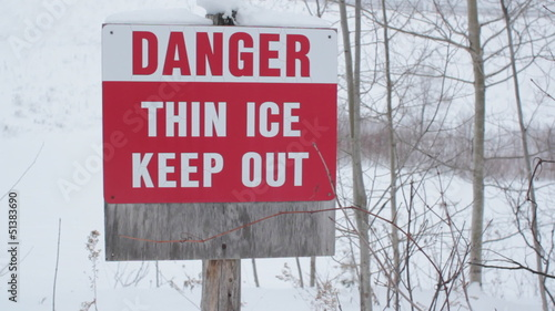 Danger. Thin Ice. Light snow falling.