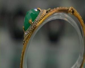 Women's jewelry bracelet with green stone 2. Medium shot