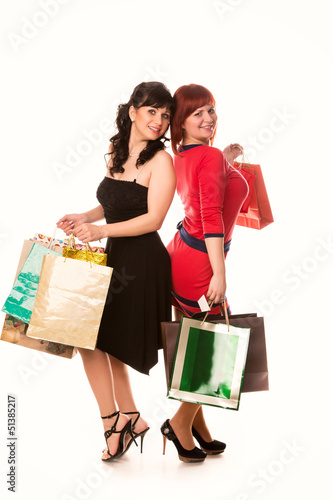 Beautiful happy girls with many shopping bags. Shopping concept.