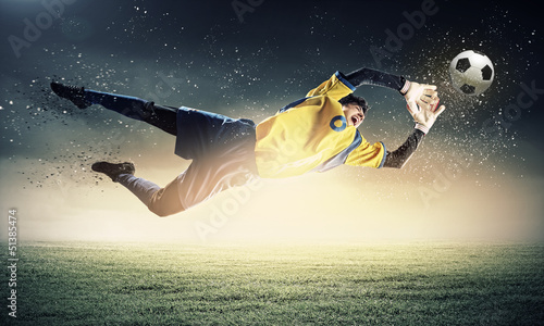 Staande foto Voetbal Goalkeeper catches the ball