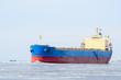 Cargo ship sailing in winter