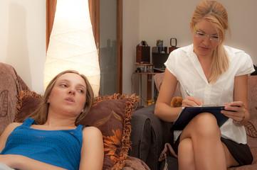 A female psycotherapist treats a teenage female patient