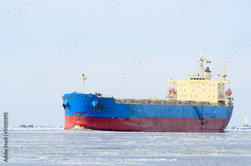Cargo ship sailing in winter