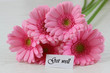 Get well note and pink gerbera daisies