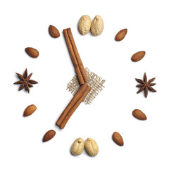 Clock of cinnamon sticks and nuts