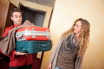 Bellhop Moving Heavy Luggage
