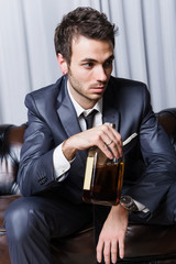 Worried Young Businessman with Drinking Problems