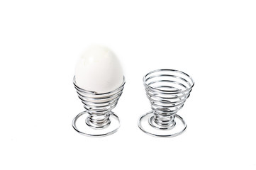 Egg in Spiral Silver Egg Cup on White Background