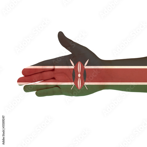 Kenya flag on hand isolated on white background
