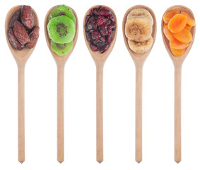 Wooden spoon with dried apricots, figs, dates, kiwi and cranberr