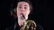 baritone saxophone player, close up