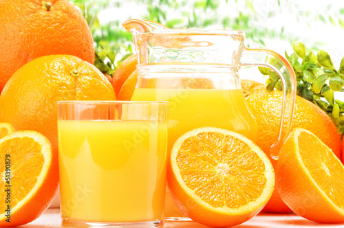 canvas print picture Glass and jug of orange juice and fruits