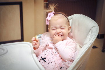 portrait joyful child with cookies