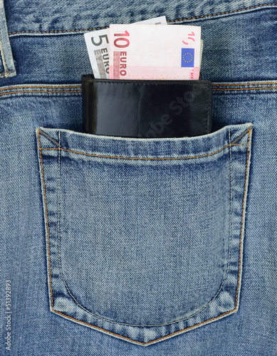 Back pocket of jeans with wallet and euro banknotes