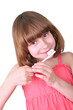 girl brushing her teeth with a toothbrush
