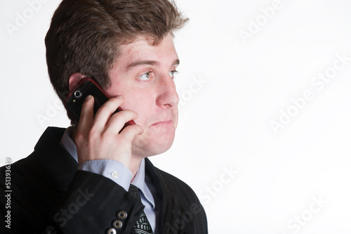 Young business man on the cell phone