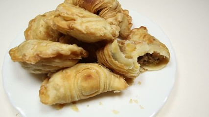 Malaysian favourite snack, curry puff on a white plate