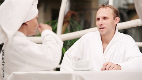 Young Couple nicely talking after morning bath
