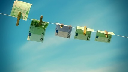 Euro banknotes  hanging on rope in wind on a blue sky background