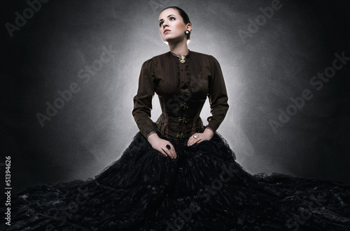 Beautiful fashionable woman in gothic style