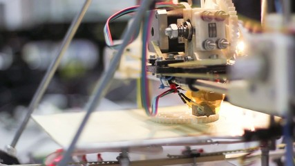 Electronic three dimensional plastic printer during work