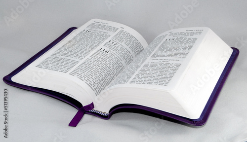 open Bible isolated on a white background.