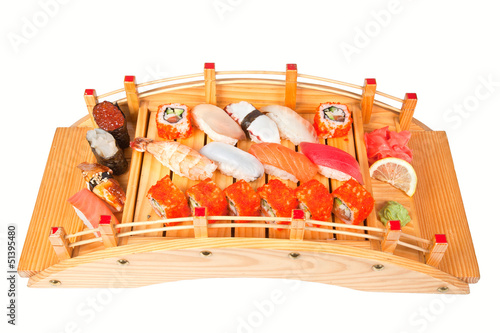 Plate with sushi set isolated on white